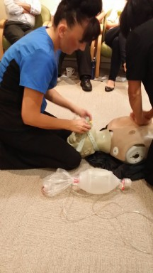 Roni setting up a Laryngeal tube for an air bag as part of medical training
