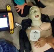 Defibrillator set up instructing us when to do compressions and when to stand clear and SHOCK