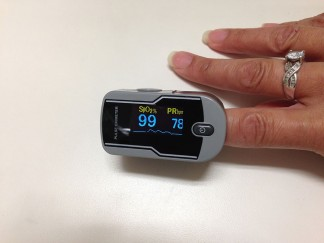 Finger pulse oximeter - oxygen saturation number on left and pulse on right