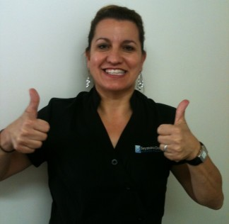 Sue is happy to be your dental nurse