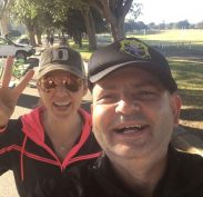 Ellie and the man at Centennial Park training and have a laugh